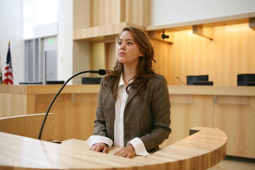 A pretty young woman testifying in court
